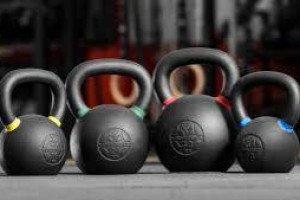 Какие гири более эффективны для роста мышц: тяжелые или легкие